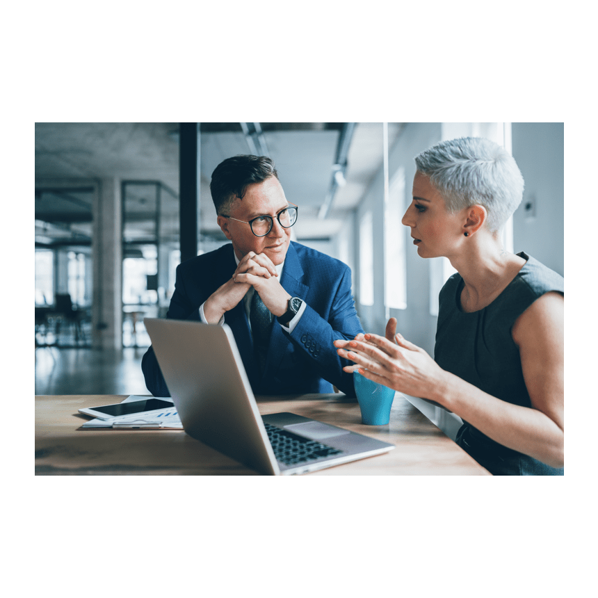 Two business professionals discuss the ServiceNow Service Provider Partner program