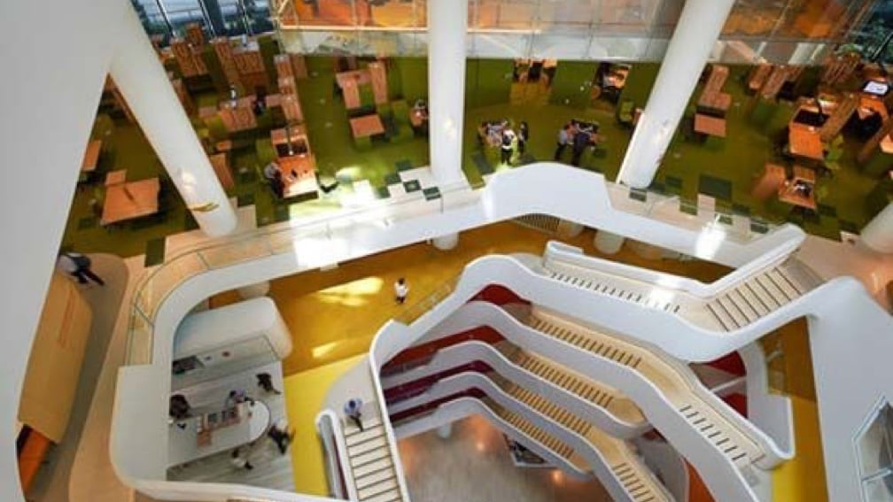 A long winding modern staircase inside an office building